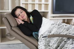 Woman resting in armchair Stock Photos