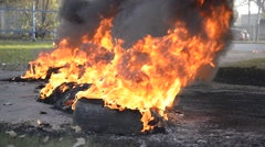 Flames and smoke emanating from tires on fire Stock Footage