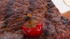 New york meat style beef steak fillet on white plate with hot chili pepper Stock Footage