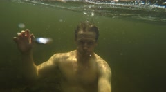 4k guy under water in stream - stock footage
