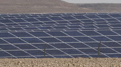 Photovoltaics in desert solar power farm in the Negev desert, Israel Stock Footage
