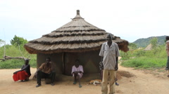 South Sudanese and Rural Village Hut Stock Footage
