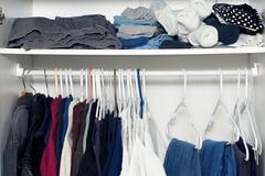 Inside wardrobe with shelf Stock Photos