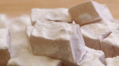 Turkish delight sweets at rotating display - closeup - stock footage