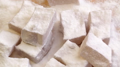 Turkish delight sweets at rotating display - closeup Stock Footage