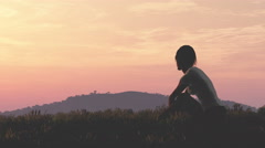 4K Young Woman Sitting on a Hilltop in Summer Sunset Sunrise 3D Animation 21  Stock Footage