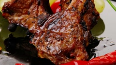 Served ribs over wooden table Stock Footage