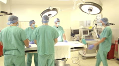Female Surgeon Briefs Surgical Team in OR - stock footage