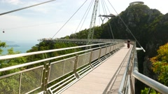 Langkawi SkyBridge perspective, cute girl pose, then come towards camera Stock Footage
