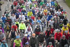 RIGA, LATVIA - MAY 31, 2015: Mass sart of Riga Cycling Marathon Folk Distance - stock photo