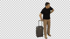 Man with a suitcase waiting for something, Full HD footage with alpha channel. Stock Footage