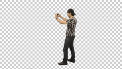 Stock Video Footage of Young man walking  with smartphone, Full HD footage with alpha channel
