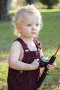 Cute Young Boy With Fishing Pole Outside at The Lake. - stock photo