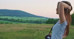Woman using digital photo camera outdoors. Making memories. Slow motion. Stock Footage