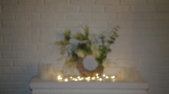 White fireplace decorated with gold decorative  fairy lights with candles Stock Footage