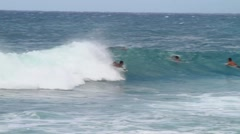 Surfing light blue water on a sunny day in Hawaii. Stock Footage
