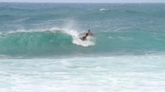 Catching a wave in Hawaii.  Stock Footage