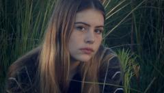 Teenage girl looking sad depressed with troubled mental illness thoughts Stock Footage