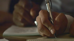 Tight Shot Hands taking Notes at Business Meeting Stock Footage