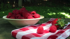 Taking one raspberry Stock Footage