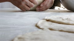 Chef flattening the dough to prepare pizza base Stock Footage