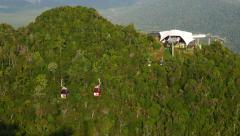 Lower cable car station at rainforest mountain peak, gondolas move up and down Stock Footage