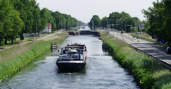 Ship on canal approaching lock Stock Footage