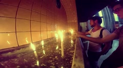 People lightning candle and praying in church of St. Anthony - stock footage