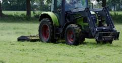 Tractor mowing grass in a meadow zoom 4K Stock Footage