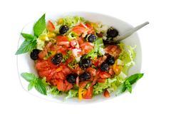 Isolated fresh plain salad garnished with mint - stock photo