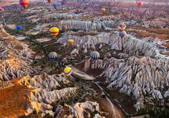 Hot air balloon flying over Cappadocia Turkey - stock photo