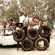 Children making Olympic Circles with tires in township, South Africa. Stock Photos