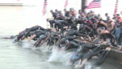 TRIATHLETES DIVE INTO HUDSON LONG SHOT Stock Footage