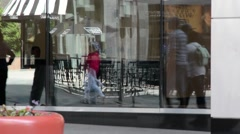 Pedestrians reflecting in store windows Stock Footage