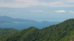 Mountain forest and sea landscape, far view perspective, tropical island peak Stock Footage