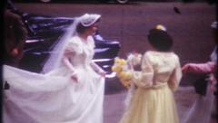2204 - bride arrives, kisses groom, walks from church - vintage film home movie Stock Footage