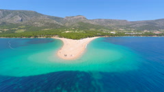 Stock Video Footage of Beautiful aerial view of Zlatni Rat beach in Bol on the island of Brac, Croatia.