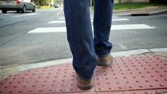Walking Behind Man Crossing Street Low POV Stock Footage