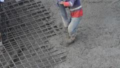 Concreting and smoothing slab on the construction site Stock Footage