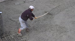Stock Video Footage of Concrete rake does a better job smoothing out chunky concrete mix