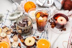cup of hot mulled wine and a delicious cup of grog among the many delicious deta - stock photo