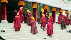 Monks enter the Grand Sutra Hall at Labrang Monastery, China Stock Footage