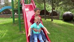 Two Kids Playing on a Public Park. View from the Front. UHD 4K steadycam stoc Stock Footage