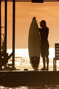 Surfer  at Sunset Tme - stock photo