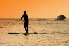 Stock Photo of Surfer  at Sunset Tme