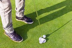 Putter on the green - stock photo