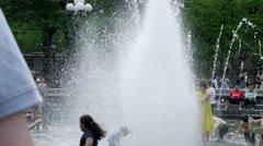 Girl children playing splashing Washington Square Park fountain slow 4K NYC Stock Footage