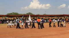 DANCERS MARCH AT POLITICAL RALLY IN SOUTH SUDAN, AFRICA Stock Footage
