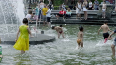Yellow dress girl summer Washington Square Park fountain playing slow motion 4K Stock Footage