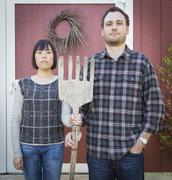 Fun Mixed Race Couple Portrait Simulating the American Gothic Painting Stock Photos